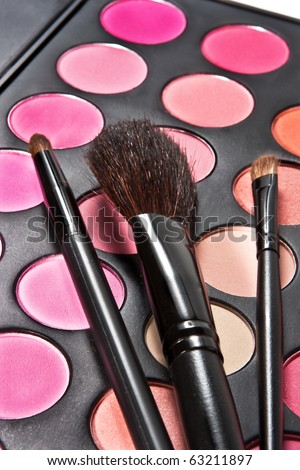 Professional make-up tools and multicolor palette - stock photo