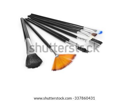 Professional make-up tools isolated on white background - stock photo