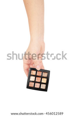 Professional makeup brush cosmetic in female hand beautician isolated on, white background