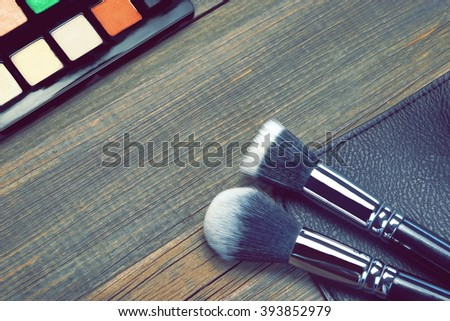 Professional Makeup Brush On Rough Brown Wood Background, Toned Image, Close-up, Top View
