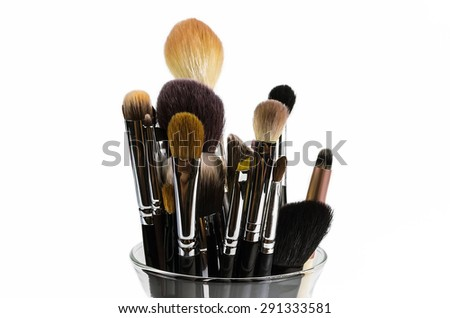 Professional makeup brushes  in a glass on a white background - stock photo
