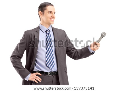 Professional male reporter holding a microphone, isolated on white background - stock photo