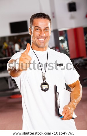 professional male school sports coach giving thumb up - stock photo