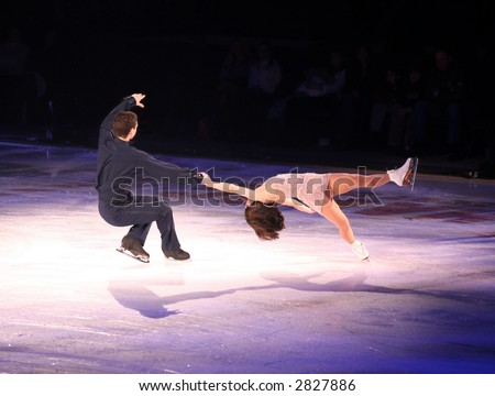Professional man and woman figure skaters performing at Stars on ice show - stock photo