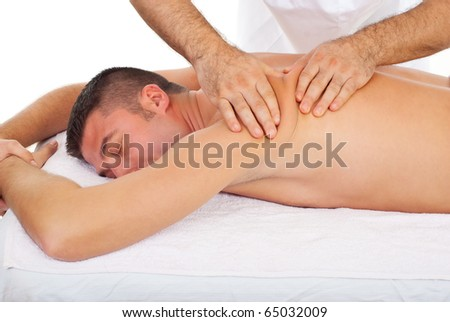 Professional masseur kneading man back skin at massage in a spa salon - stock photo