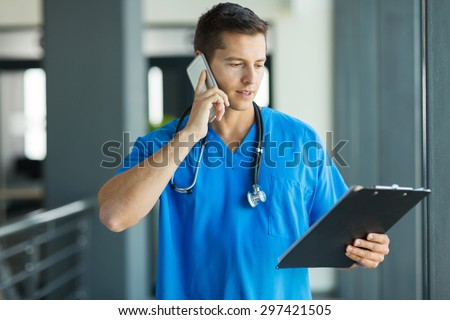 professional medical doctor talking on mobile phone in hospital - stock photo