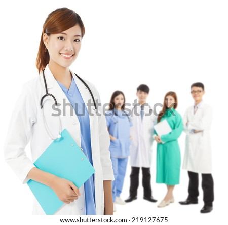 Professional medical doctor with her  team standing over white background - stock photo