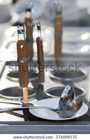 professional metal pots cooker with ladles - stock photo