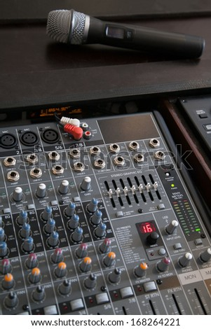 Professional microphone and line mixer with effects and selective focus - stock photo