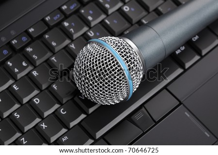 Professional microphone on laptop keyboard