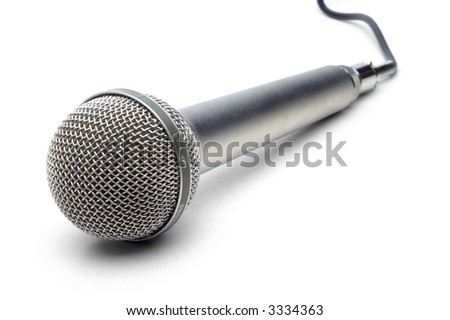 Professional microphone with attached cable on white background - stock photo