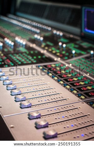Professional mixing console in studio - stock photo