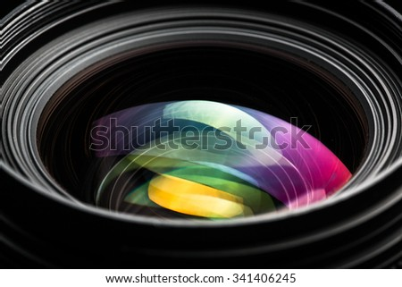 Professional modern DSLR camera llense ow key image - Modern DSLR camera lense with a very wide aperture - stock photo