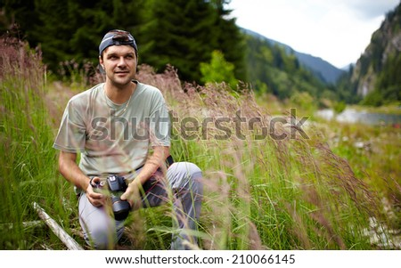 Professional nature photographer outdoor in the wild - stock photo