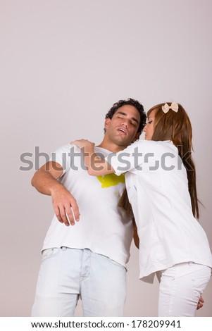 professional nurse holding sick fainting man, studio isolated on white background - stock photo