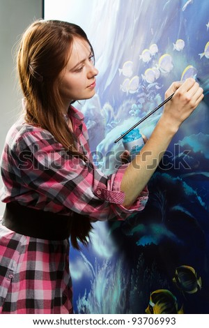 Professional painter at work, painting a home interior
