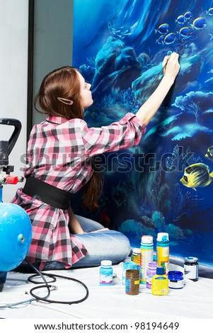 Professional painter at work, painting a home interior - stock photo