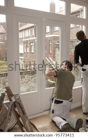 Professional painters working inside a home