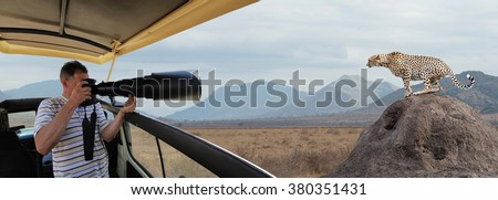 Professional photographer on safari in Kenya - stock photo