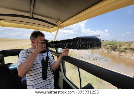 Professional photographer on safari in Kenya