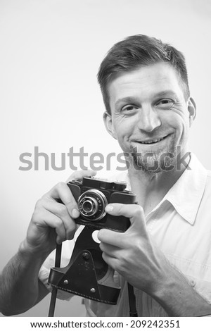 Professional photographer takes pictures with joy - stock photo