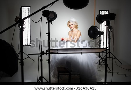 professional photography studio showing behind the scenes lights on bride model - stock photo