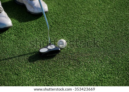 Professional Player  play at Golf Course. Golfer holding a a club and is going to hit the golf ball. - stock photo