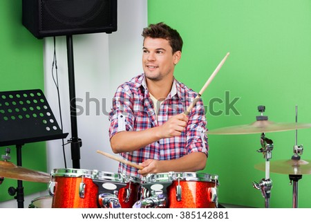 Professional Playing Drums And Cymbal In Recording Studio - stock photo