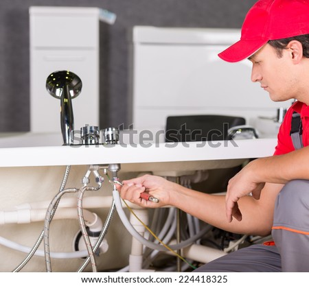 Professional plumber. Plumbing repair service. - stock photo
