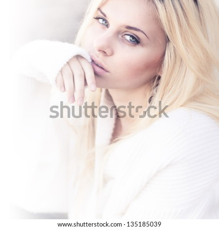Professional portrait of a beautiful girl dreaming - stock photo