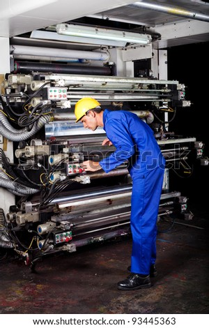 professional printer operating modern industrial printing machine - stock photo