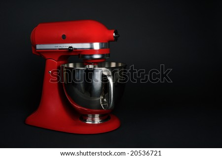 Professional red kitchen mixer appliance. - stock photo