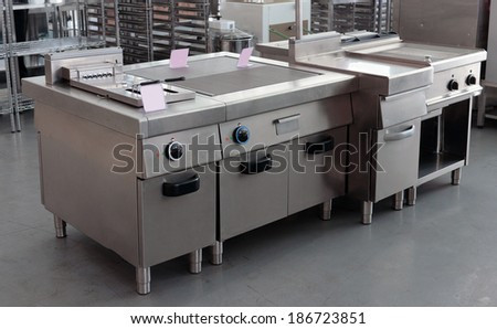 professional restaurant equipment in the shop - stock photo