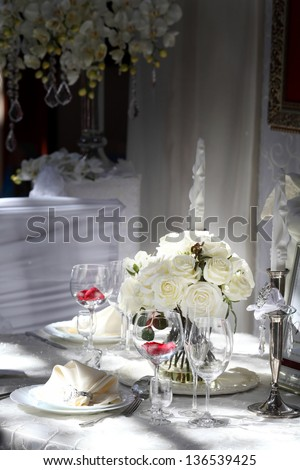 Professional restaurant serving with glasses and plates - stock photo