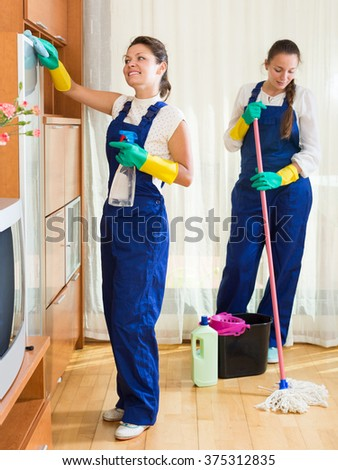 Professional russian cleaners cleaning in room