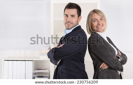 Professional senior and junior business team in portrait at the office with white background. - stock photo