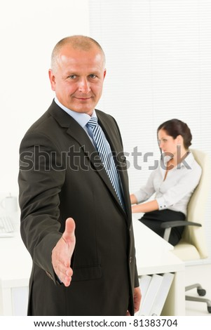 Professional senior businessman handshake in office with secretary