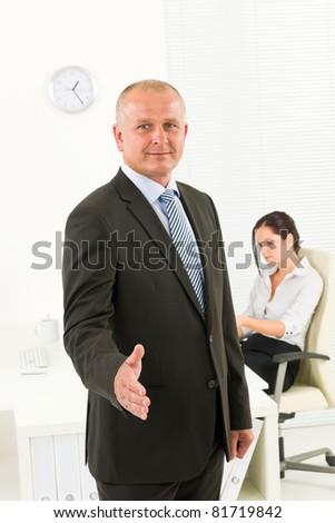 Professional senior businessman handshake in office with secretary - stock photo