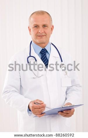 Professional senior doctor male with stethoscope portrait write document folders - stock photo