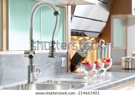 Professional single lever faucet in modern kitchen - stock photo