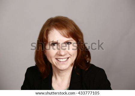 professional smiling woman with red hair