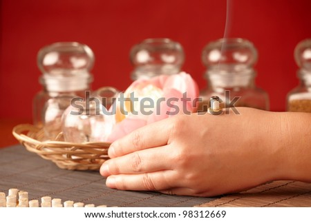 Professional smoking mini moxa stick on human hand - stock photo