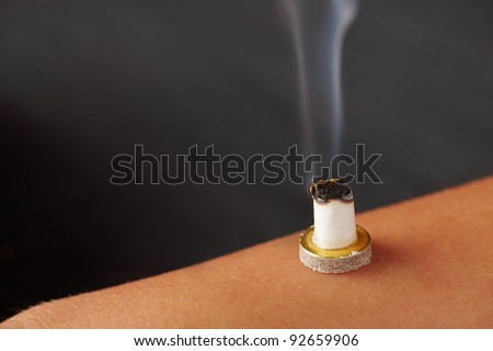 Professional smoking mini moxa stick with copy space for your text - stock photo