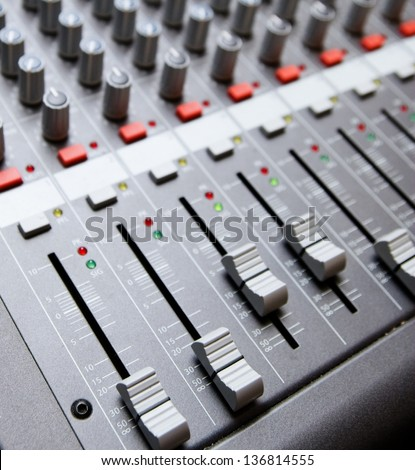 Professional sound recording studio mixer.Audio equipment to record voice,music and sound.Concert mixer,mixing console for sound technician.Close up.Focus on volume regulator knobs.