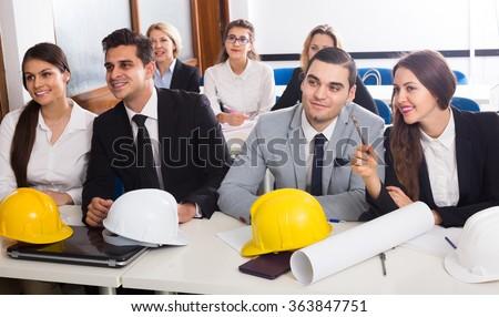 Professional spanish architects having advanced training courses in classroom - stock photo