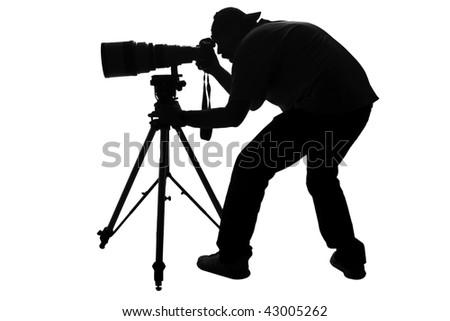 Professional sports photographer silhouette - stock photo