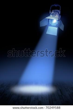 Professional stage spotlight lamp beam  glowing on dark background - stock photo