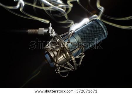 Professional Studio Microphone.  light brush - stock photo
