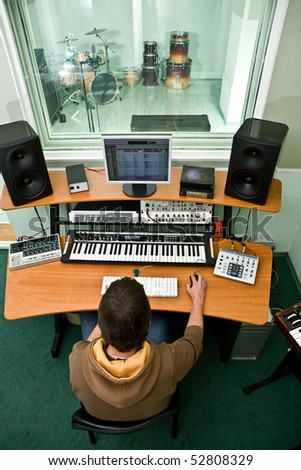 Professional studio recording equipment, room with drums, soun master - stock photo