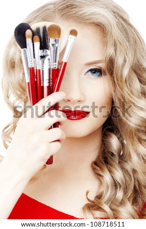 Professional stylist with make-up brushes - stock photo